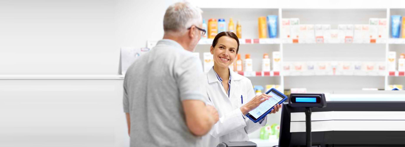 senior man consulting to the pharmacist