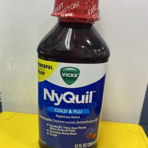Vicks NyQuil , red transparent bottle, white and yellow background