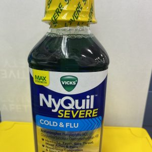 NyQuil Severe, Green Tranparent Bottle, white and yellow background